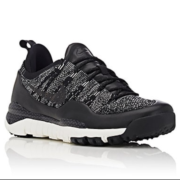 4feddf91b4c5 Nike Men s Lupinek Flyknit Low Walking Sneakers. M 5a9c72cba4c4859066b03c5a